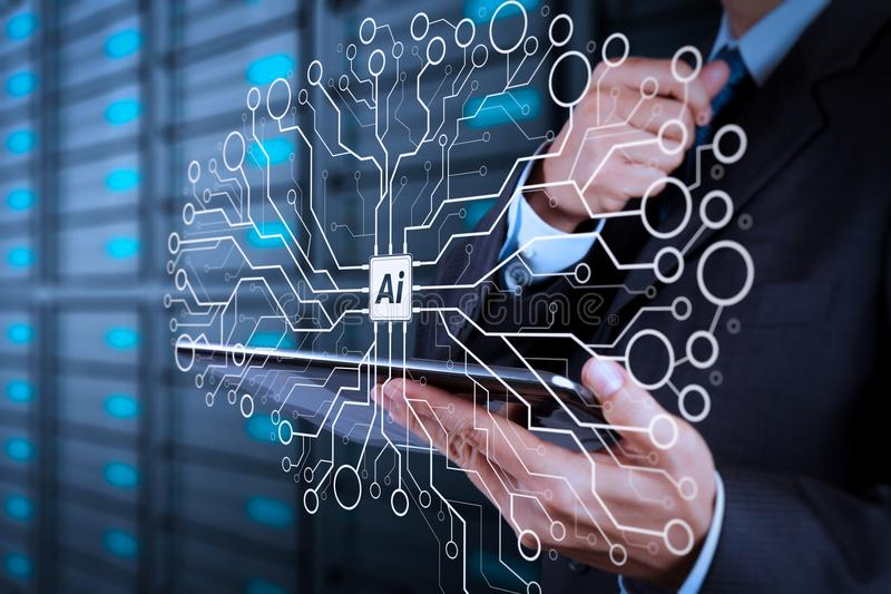 Businessman hand using tablet computer and server room. Artificial Intelligence (AI),machine learning with data mining technology on virtual dachboard royalty free stock photography