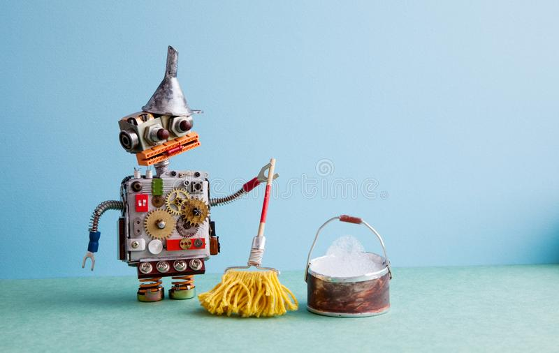 Artificial intelligence cleaning service concept. Robot washer with mop and bucket of water, mopping floor. Creative. Design toy metal funnel hopper, cogs royalty free stock photos