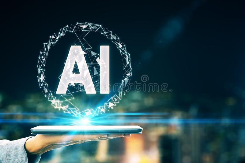 Artificial intelligence concept with AI letters and human hand with digital tablet stock image