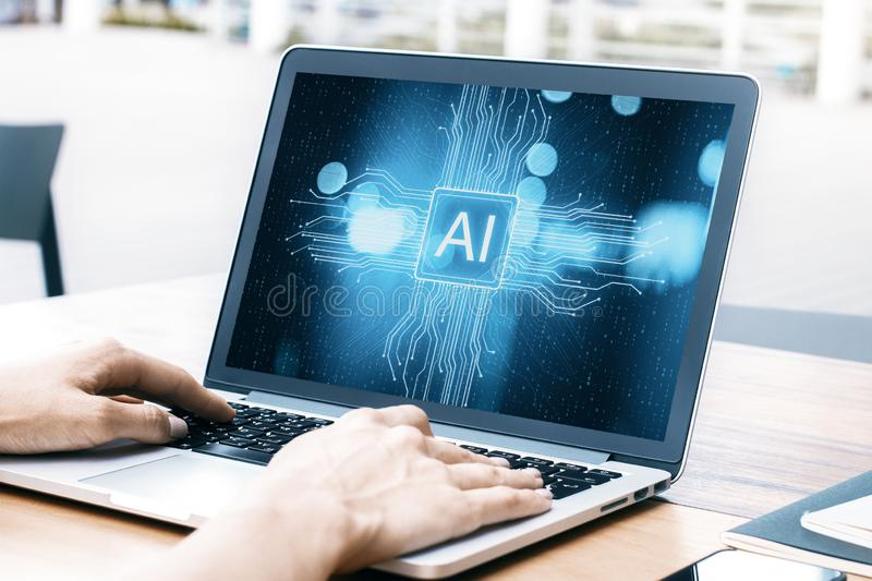 Artificial intelligence concept. Close up and side view of hands using laptop with creative AI circuit on screen. Artificial intelligence concept royalty free stock image