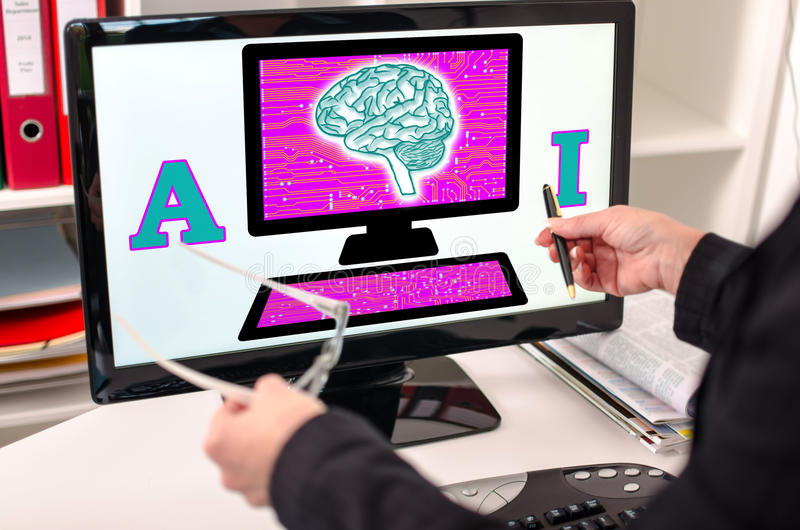 Artificial intelligence concept on a computer monitor. Businesswoman showing artificial intelligence concept on a computer screen royalty free stock photos