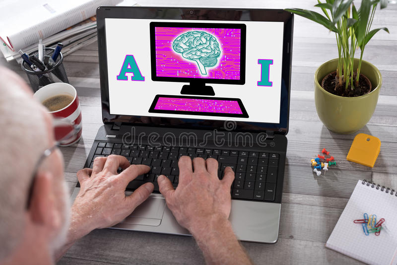 Artificial intelligence concept on a laptop screen. Artificial intelligence concept shown on a laptop used by a man stock image