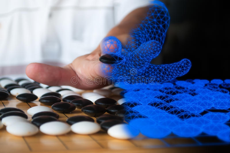 Artificial Intelligence Go player concept. Human plaing Go blended to blue computer wireframe representing artificial intelligence concept stock image