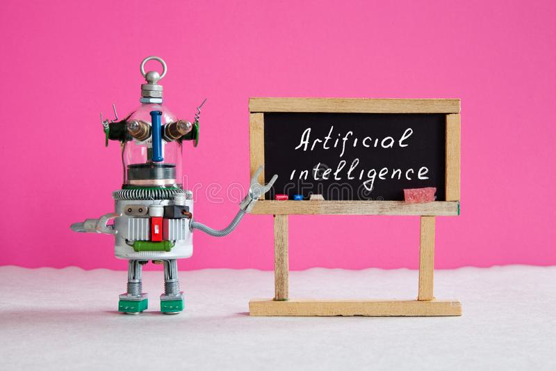 Artificial intelligence and machine learning cocnept. Funny robotic futuristic character, black chalkboard with royalty free stock photo