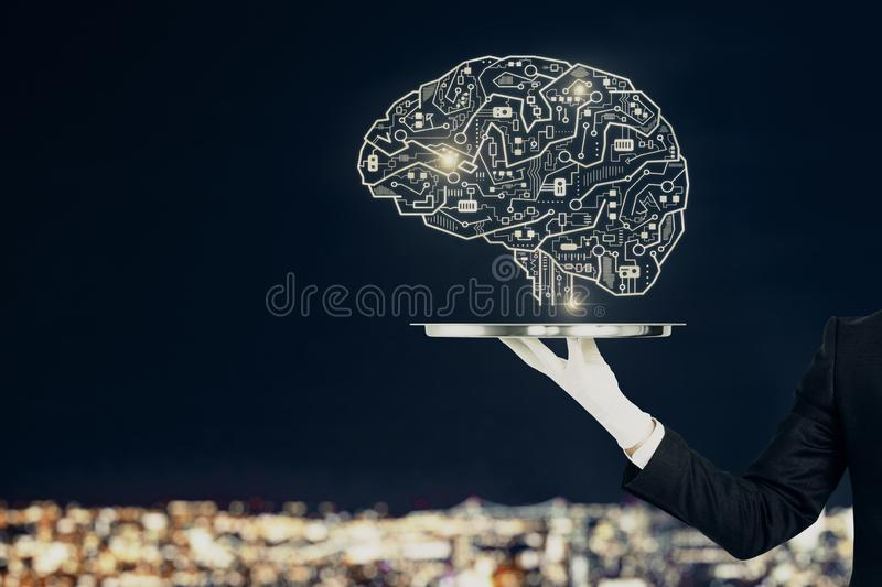 Artificial intelligence and service concept. Hand with creative circuit brain on blurry night city background. Artificial intelligence and service concept royalty free stock photography