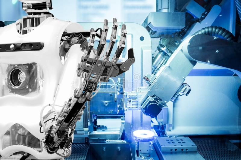 Artificial Intelligence to work replacing humans in modern industries, industry 4.0 concept. Artificial Intelligence on industrial robotics in blue tone color stock photo