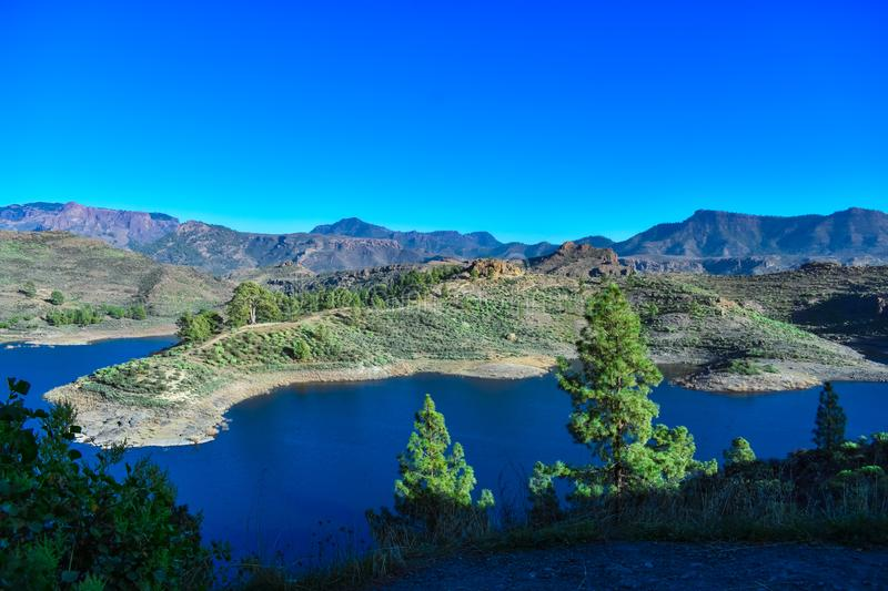 ARTIFICIAL LAKE. This artificial lake called prey of girls in spanish presa de las niñas is located in gran canaria island and is considered one of the stock photo