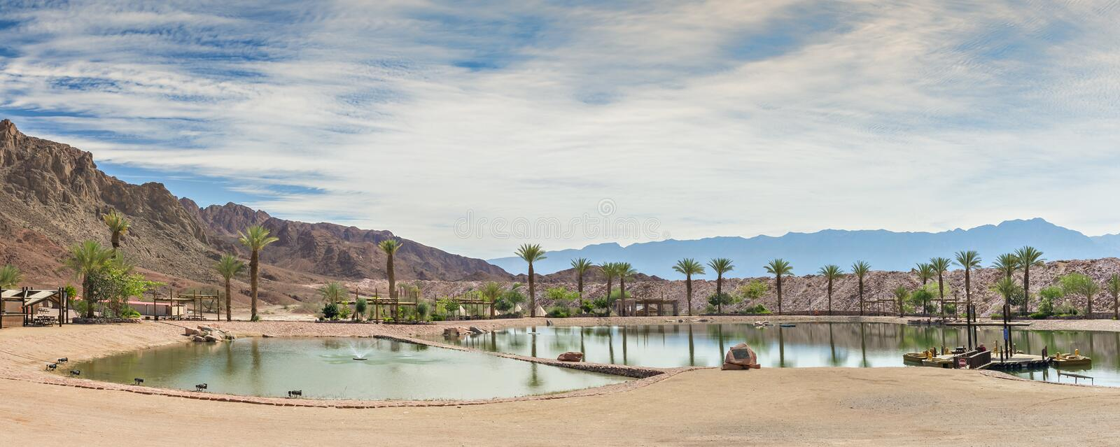 Artificial lake in geological desert Timna park. National Timna Park, located 25 km north of Eilat, combines beautiful scenery with special antiquities, history royalty free stock photos