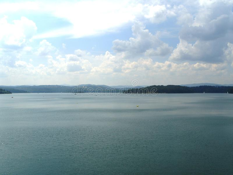 The artificial lake near the dam in poland stock photography