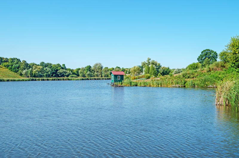Artificial lake. View of the pond in clean rural midday in late August royalty free stock photography