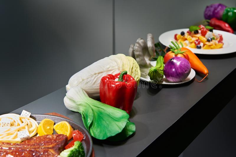 Artificial models of foods in storefront stock photography
