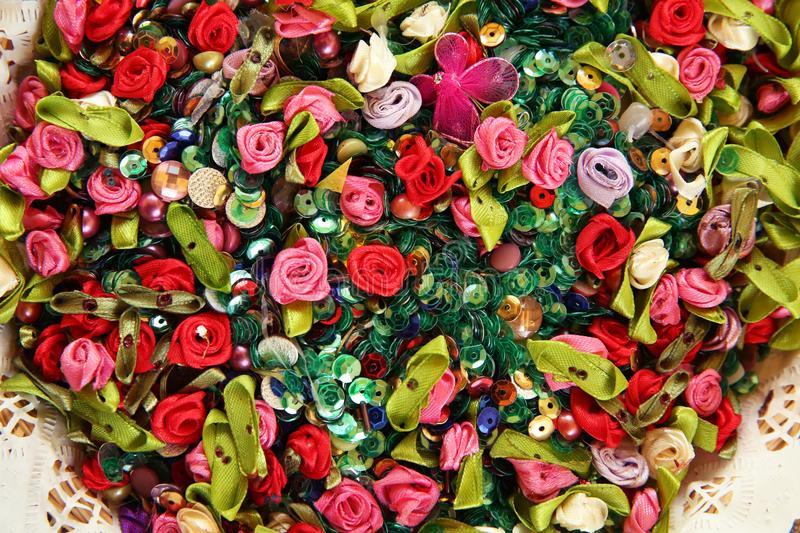 Artificial multicolored flowers . Beautiful multicolored artificial flowers background. flowers decor. The small colorful fabric f royalty free stock photo