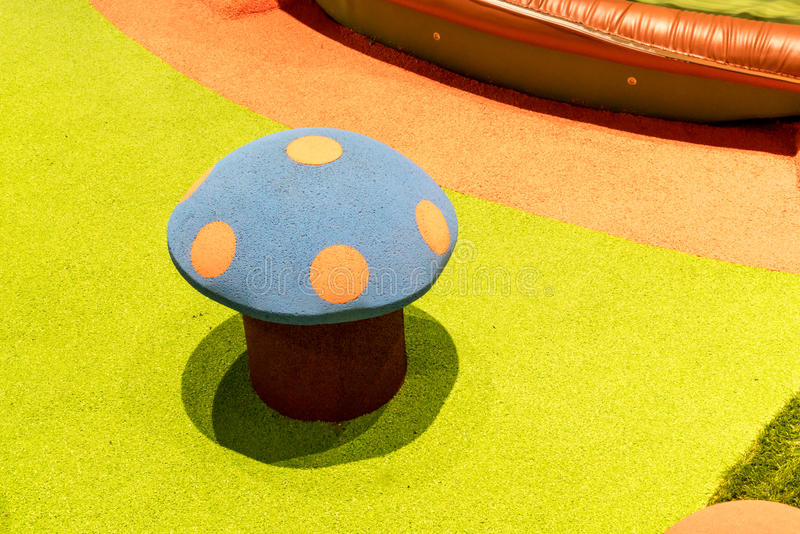 Artificial mushroom at Colourful Playground For Children stock image