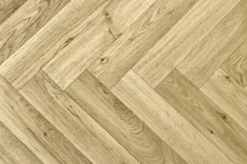 Artificial parquet floor. Full frame detail of a artificial wooden parquet floor royalty free stock photo