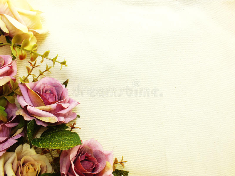 Artificial purple rose flowers with space copy border background. Purple rose artificial flowers with space copy border background royalty free stock photos