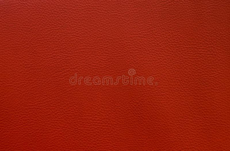 Artificial red leather close up texture background small pattern royalty free stock photography