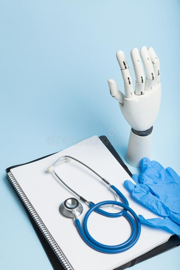 Artificial robotic prosthesis. Doctor holds cyber hand stock images