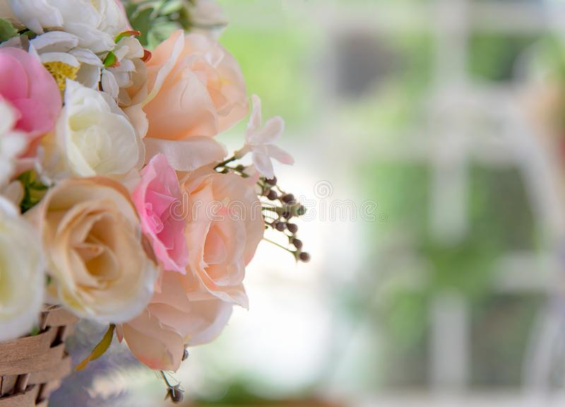 Artificial roses bouquet in soft focus stock photos