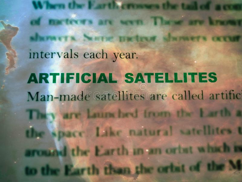 artificial satellite words displaying on galaxy abstract background stock images