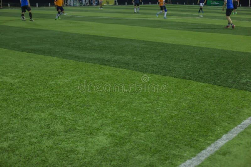 Artificial sports grass football field stock images