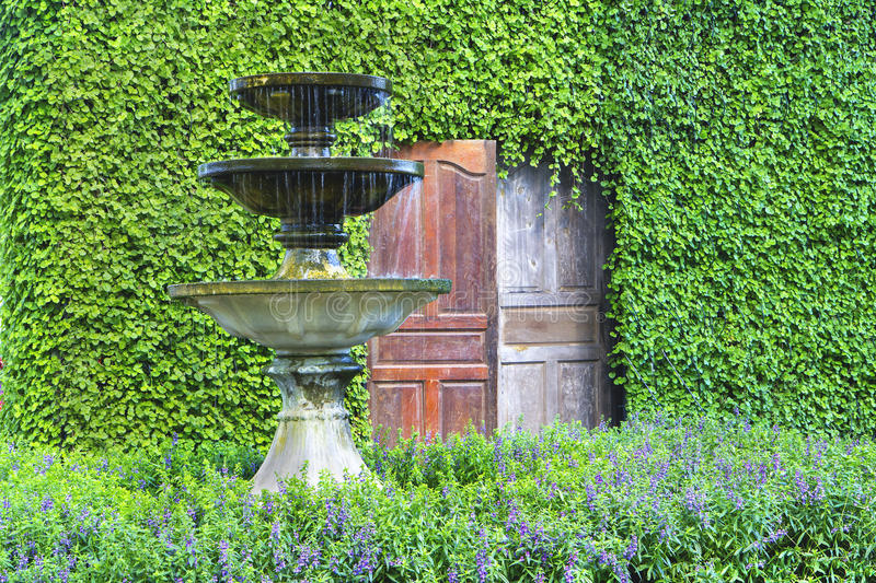 Artificial spring water in a garden royalty free stock images
