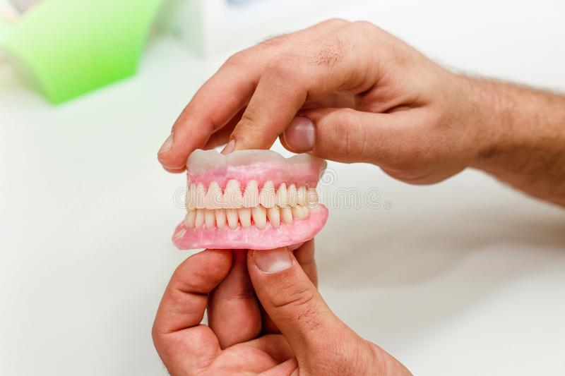 Artificial teeth arrangement of full mouth royalty free stock photography