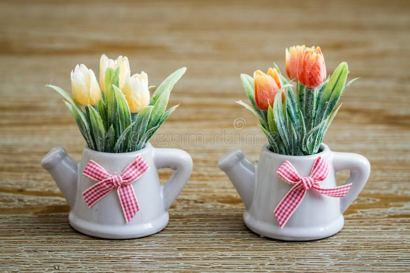 Artificial Tulips in White Porcelain Pots with Teapot Design and royalty free stock images
