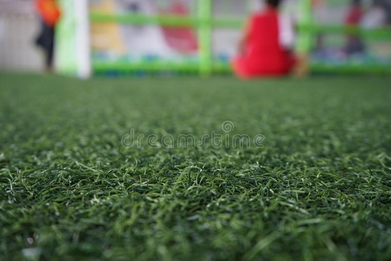 Artificial turf in the playground and blurred background royalty free stock photo