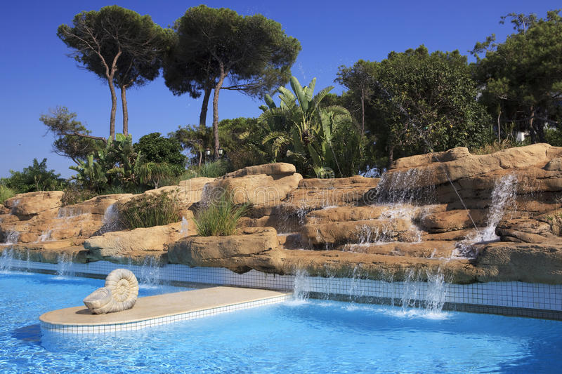 Artificial waterfall in the pool. stock photography
