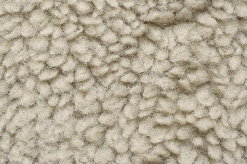 Artificial wool like sheepskin. Artificial fur light color roll up into many smaller of parts stock photography