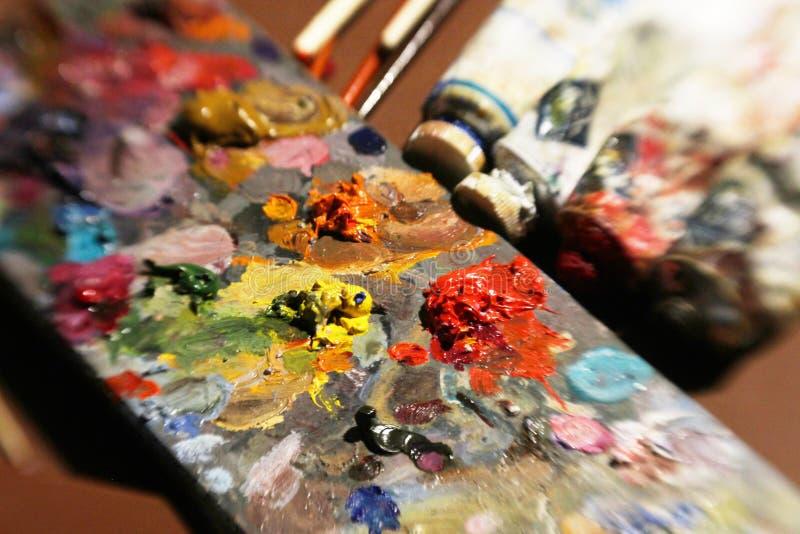 Artigos a pintar com pinturas de óleo ilustração stock
