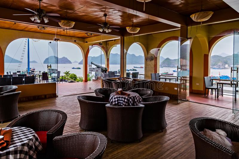 artillery canon interior terrace summer cafe. Restaurant sea terrace by the seaside. Halong Bay Vietnam stock photography