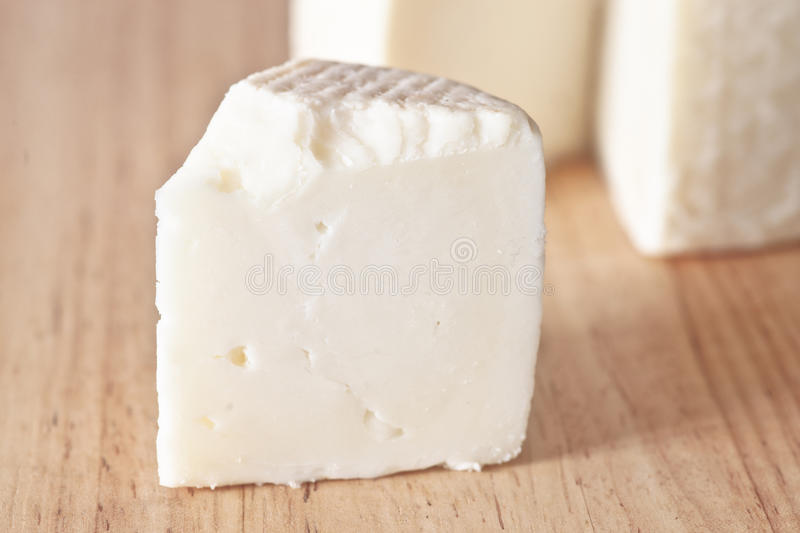 Artisan Cheese. On wooden board stock photography