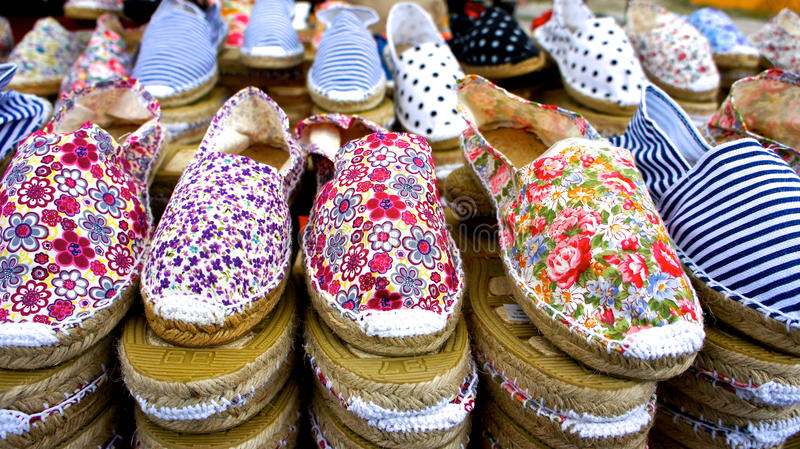 Artisan handmade shoes at market stall stock image