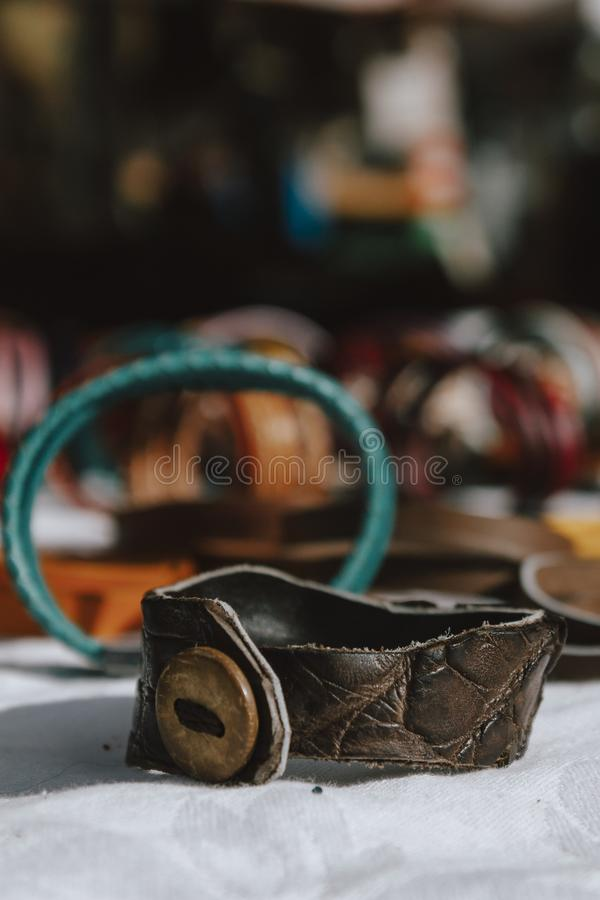 Artisan leather bracelet, sale of handmade products. Entrepreneurs creating products to sell. Artisan leather bracelet, sale of handmade products. Entrepreneurs royalty free stock photo