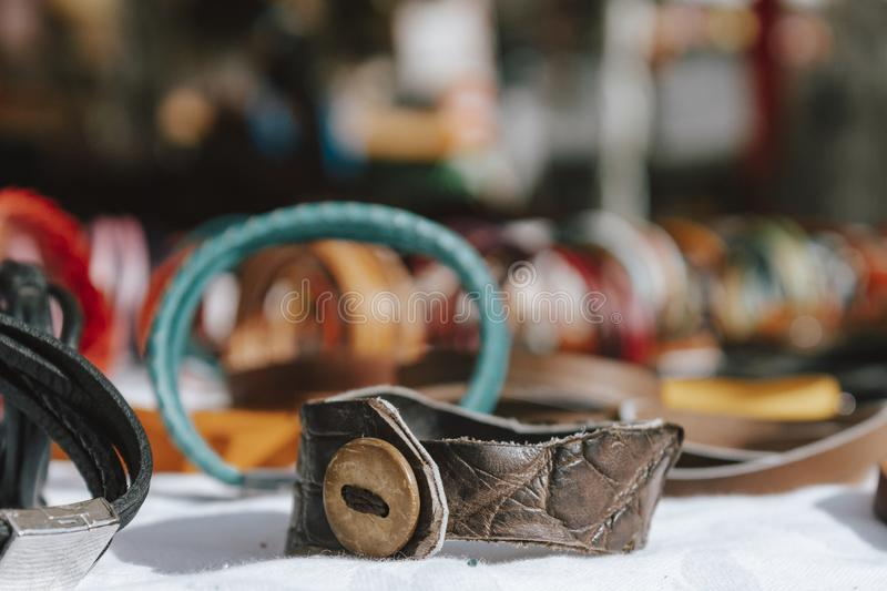 Artisan leather bracelet, sale of handmade products. Entrepreneurs creating products to sell. Artisan leather bracelet, sale of handmade products. Entrepreneurs stock image