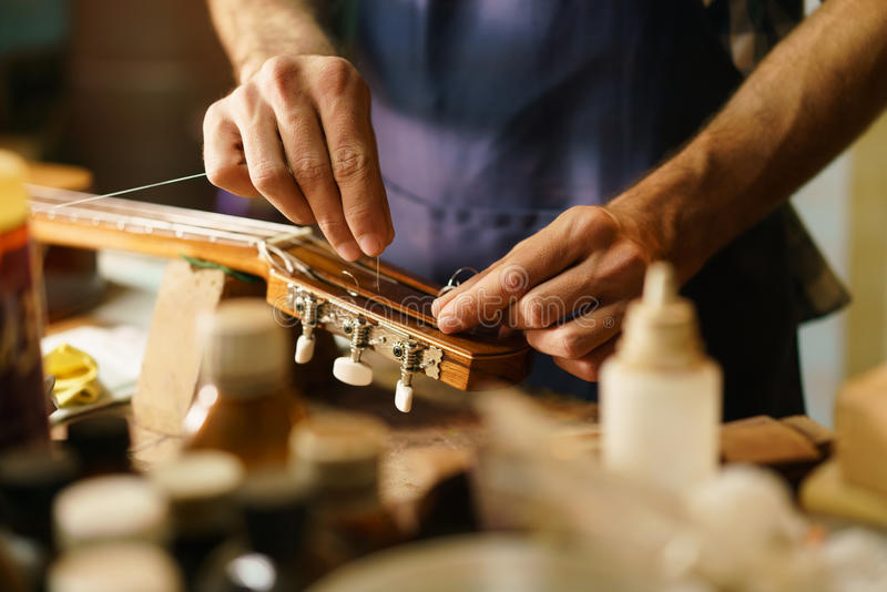 Artisan Lute Maker Fixing Stringed Instrument Replacing Guitar C royalty free stock images