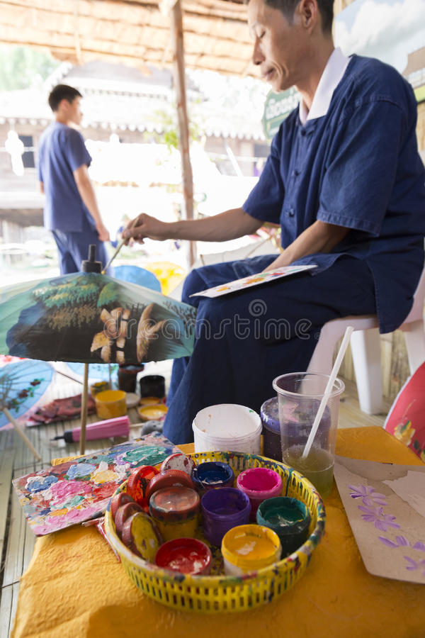 The artisan painting picture on traditional Thailand lanna paper stock images