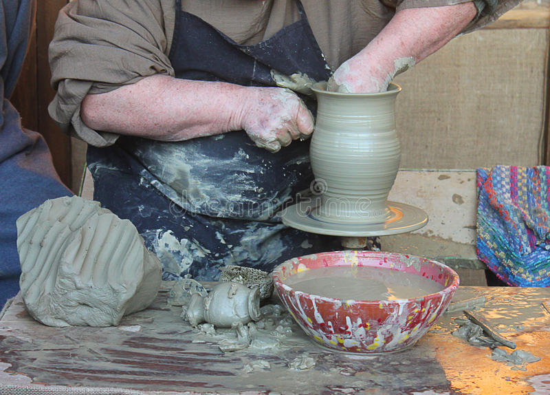 Artisan who creates a vase. An artisan who creates a vase royalty free stock photo