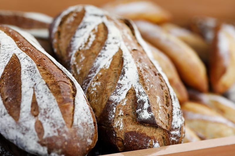 Artisanal bread on the wooden shelf in the bakery royalty free stock photo