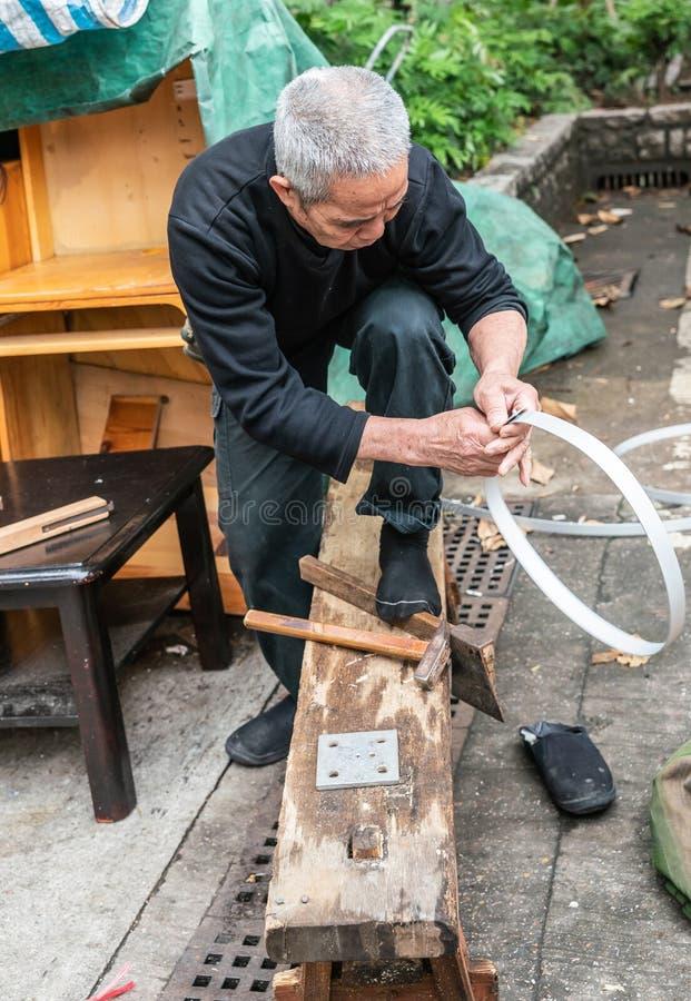 Artisanal cooper or barrel maker at Tai Po Market, Hong Kong China royalty free stock images
