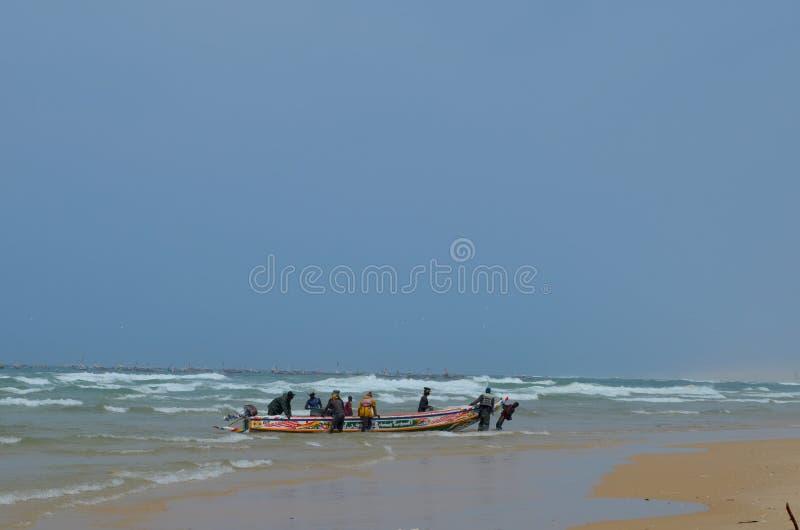 An artisanal fishing boat pirogue in Kayar/Cayar beach, north of Dakar royalty free stock photo