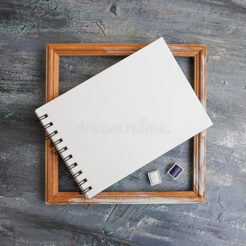 Artist Album Mock Up Template with brush and paints royalty free stock photo