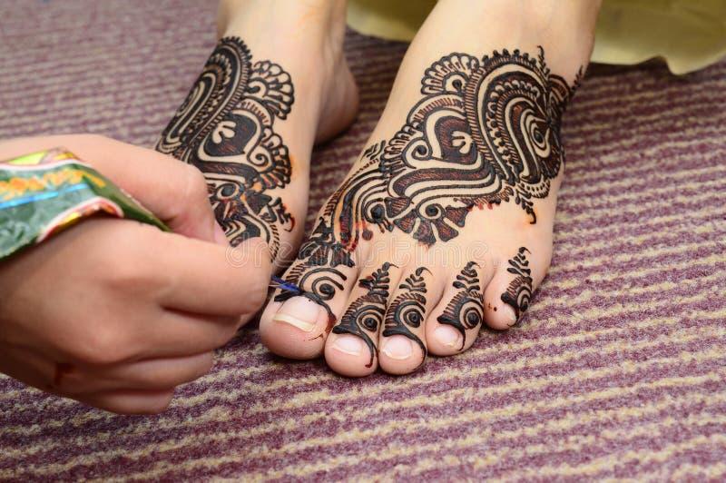 Mehndi For Foot : Artist applying mehndi stock photo. image of horizontal 79417836