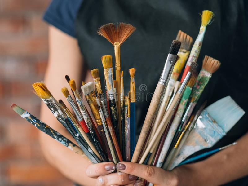 Artist art supplies tools woman paintbrushes bunch royalty free stock photos