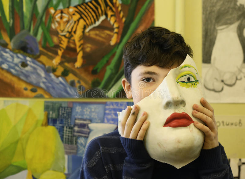 Artist boy studentin art school final exhibition. Moscow, May 23 2017: Art school student boy with his painting on final annual exhibition show in Moscow, Russia stock images