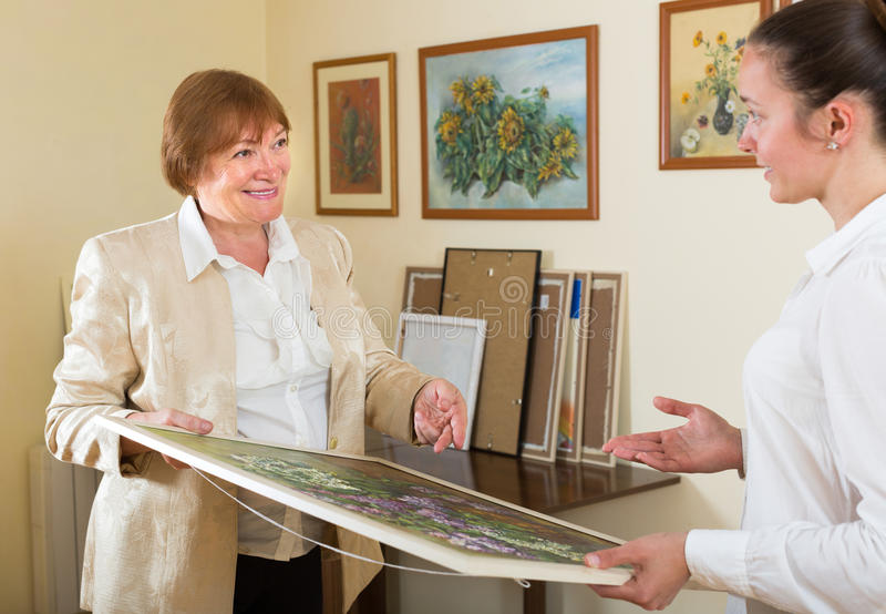 Artist with buyer the picture stock photography