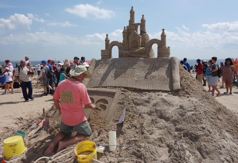 Artist creates sand sculpture on the Coney Island Beach during the 27th Annual Coney Island Sand Sculpting Contest. BROOKLYN, NEW YORK - AUGUST 19, 2017: Artist stock image