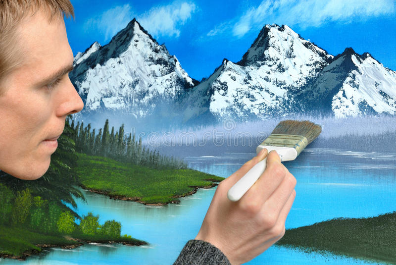 Artist creating a landscape painting royalty free stock images