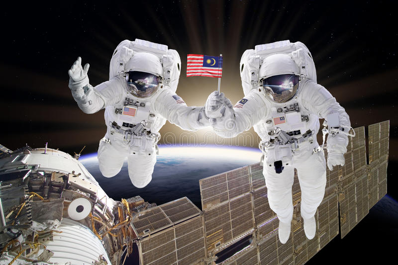 Artist creative edit composite depicting teamwork on ISS stock photo
